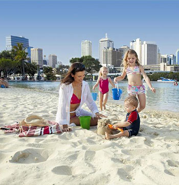 Family building sand castle at South Bank beach in Brisbane