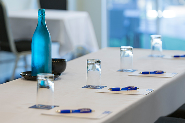 row of pens on notepads on table in conference room in Coolangatta at Oaks Calypso Plaza resort on Gold Coast, Australia