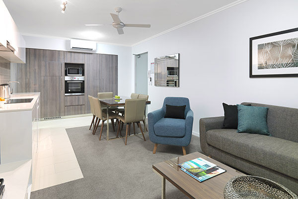 air conditioned living room in two bedroom apartment at affordable hotel in Mackay with comfortable furniture