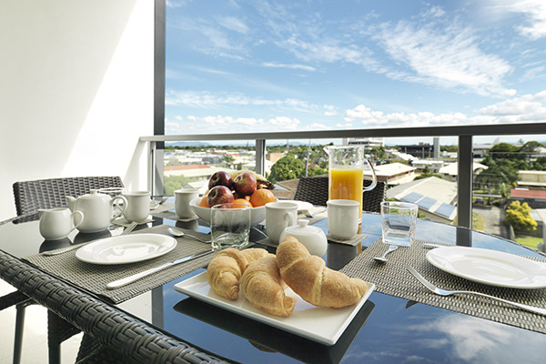 healthy hotel breakfast on balcony of three bedroom apartment at Oaks Mackay hotels with wi-fi at Oaks Carlyle hotel
