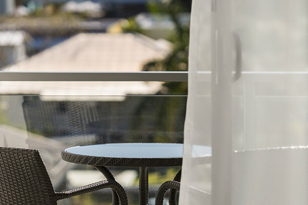 hotel room balcony with views of Mackay in Queensland and comfortable chairs and table
