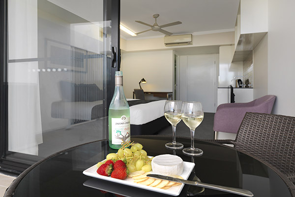 Best hotels Mackay with wine, cheese and biscuits on table on balcony of hotel room at Oaks Carlyle in Mackay, QLD