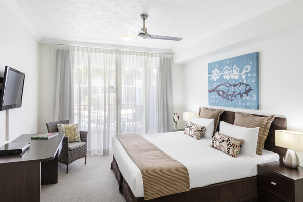 large bedroom with wi-fi air conditioning and television at Oaks Lagoons holiday resort in Port Douglas near ocean