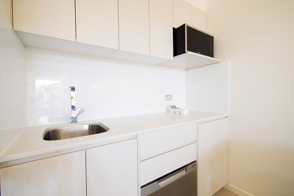 kitchen with microwave, toaster and mini-fridge in 2 bedroom dual key hotel apartment at Oaks Oasis Resort in Caloundra on Sunshine Coast, Queensland, Australia