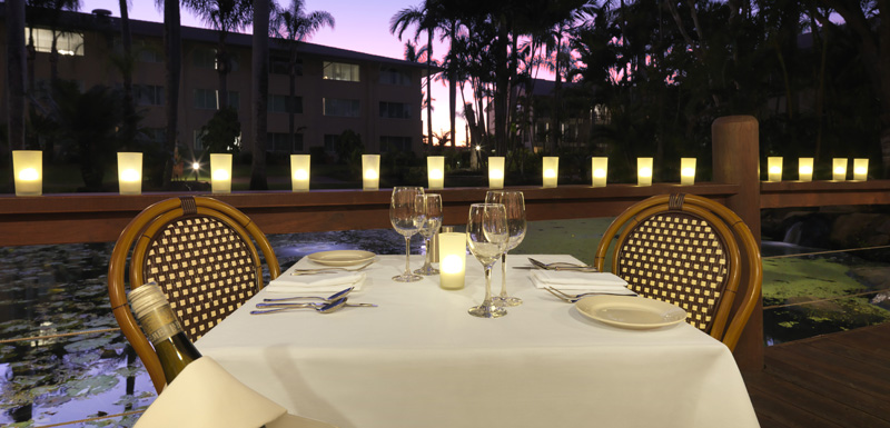 table for 2 on romantic date with bottle of wine and glasses at Reflections Restaurant and Bar in Caloundra, Sunshine Coast