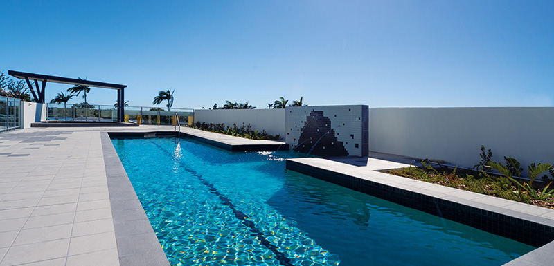 outdoor swimming pool for guests to swim in while staying at Oaks Rivermarque hotel in Mackay in summer