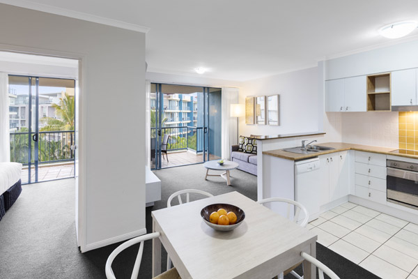 open plan air conditioned one bedroom apartment with private balcony walking distance to beach at Oaks Seaforth Resort hotel