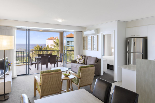 Sunshine Coast hotels with open plan apartment with comfortable furniture and work desk for corporate travellers visiting Sunshine Coast on a business trip