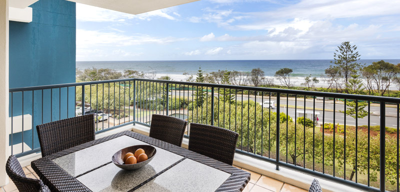 fruit bowl on table with chairs on balcony of 2 bedroom apartment with ocean views of sea at Oaks Seaforth Resort hotel, Sunshine Coast, Queensland, Australia