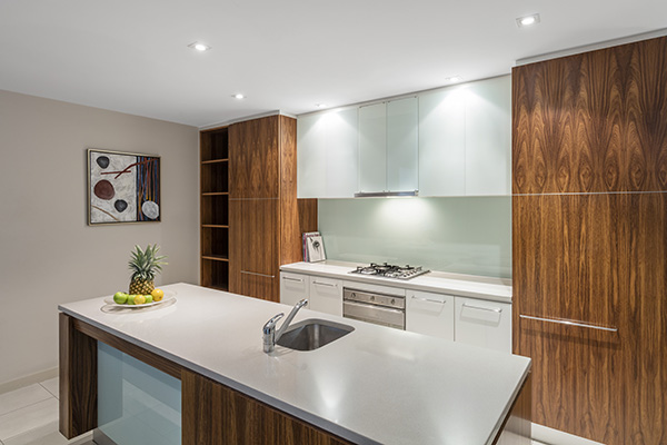modern kitchen with oven, microwave and kettle in family friendly 2 bedroom apartment in Adelaide city near Convention Centre