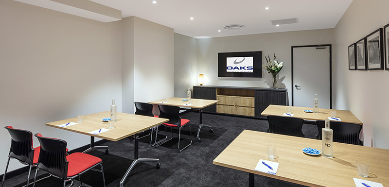 4 tables in large, air conditioned conference room with Wi-Fi for hire in Adelaide city with chairs, TV and catering available