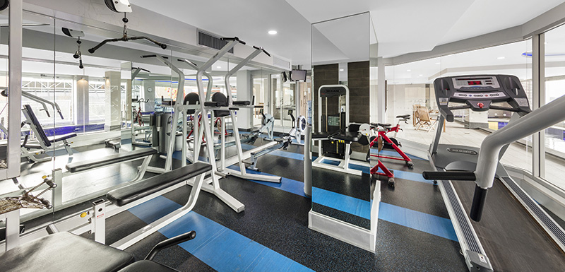 fully equipped gymnasium in Adelaide city with weights, treadmill, rowing machine and air conditioning at Oaks Embassy Hotel near Convention Centre