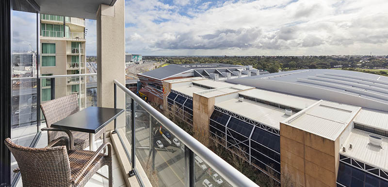 balcony with table and 2 chairs and view of Adelaide Convention Centre across the road