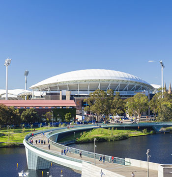 bridge over river leading to Adelaide Oval cricket and AFL stadium