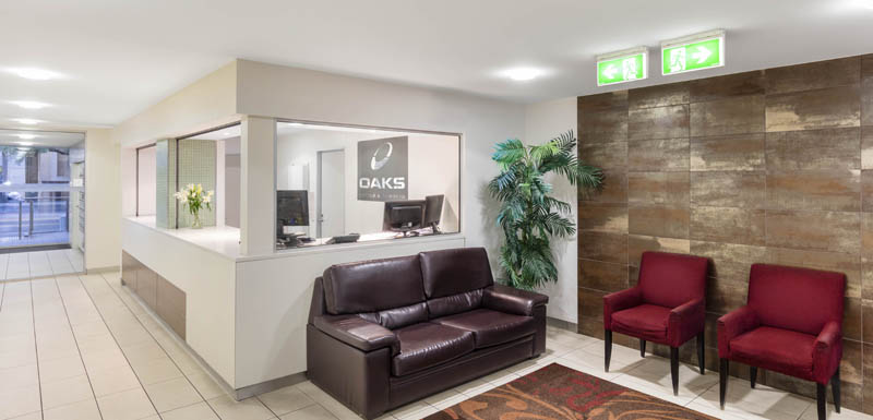 friendly hotel staff at desk of reception room at iStay Precinct hotel in Adelaide, South Australia