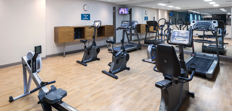 fully equipped hotel gym with air conditioning, weights, treadmill and workout machines at Oaks Plaza Pier in Glenelg South Australia