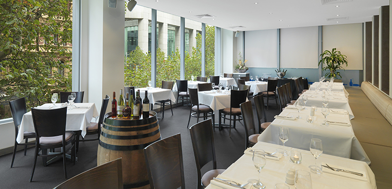 row of tables with cutlery, champagne glasses and a selection of wines on vegetarian menu at First Floor Restaurant in Melbourne city