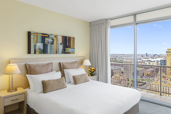 comfortable double bed in air conditioned melbourne hotel apartments, family friendly 3 Bedroom unit with small balcony and Wi-Fi access at Oaks On Lonsdale hotel in Melbourne city centre, Victoria, Australia
