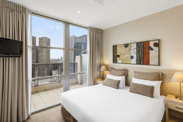 double bed in air conditioned bedroom with Wi-Fi access and Foxtel on TV in Hotel Apartment with private balcony at Oaks On Lonsdale in Melbourne city, Victoria, Australia