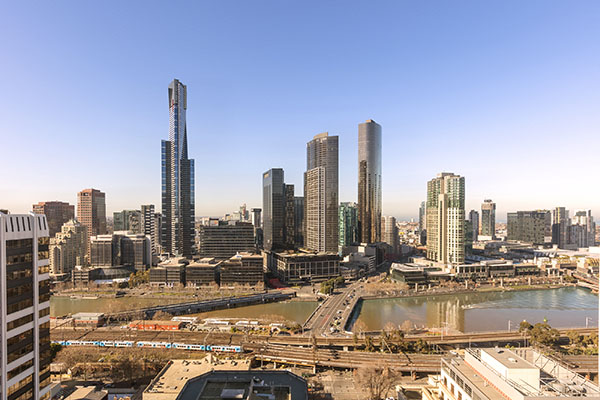 beautiful aerial view of Melbourne city at dusk from private balcony of 2 Bedroom Apartment at Oaks on Market hotel