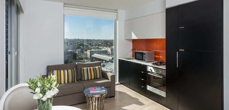 air conditioned living room in large hotel Studio Apartment with private balcony and free Wi-Fi at Oaks South Yarra, Melbourne city, Victoria, Australia