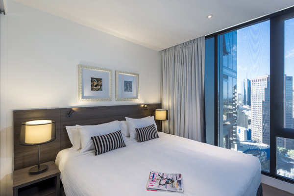 Hotels in Southbank Melbourne double bed in air conditioned master bedroom of hotel apartment at WRAP On Southbank in Melbourne CBD