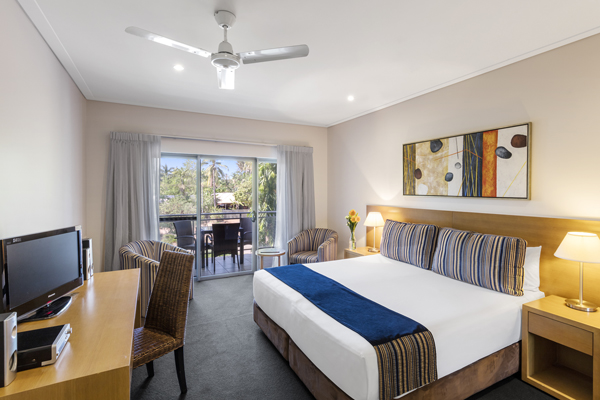 accommodation in Broome with Foxtel on table desk in front of double bed in air conditioned bedroom of popular hotel in Western Australia