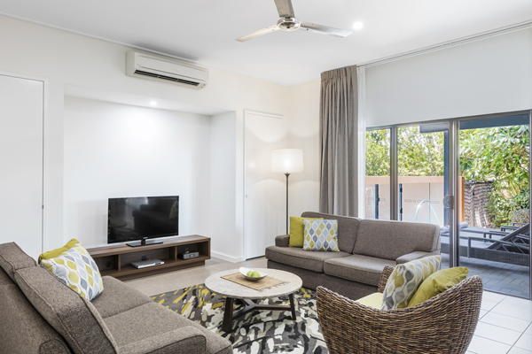 children on family holiday to Broome, Western Australia sitting in air conditioned 3 Bedroom Apartment with Wi-Fi at Oaks Cable Beach Sanctuary hotel in Broome, Western Australia