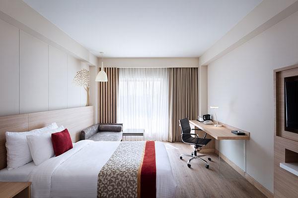 Oaks Bodhgaya India - Deluxe Room with Shower - Bedroom