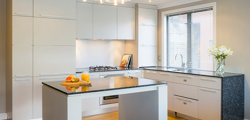 big kitchen with stove top cooker, hot plates, microwave, toaster and kettle in 4 bedroom holiday penthouse apartment in Queenstown, New Zealand