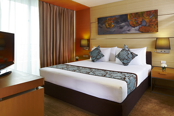 large comfortable bed in spacious 1 Bedroom Apartment suite with air con, Wi-Fi and satellite TV at Oaks Bangkok Sathorn hotel in Thailand