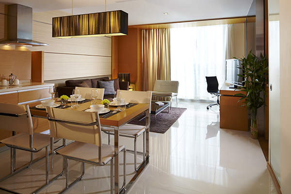 desk and office chair in 1 Bedroom Suite for corporate travellers to do work while visiting Bangkok on business trip to Thailand