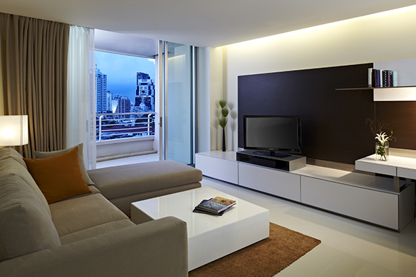 large flat screen TV in living room with Wi-Fi access and private balcony outside with beautiful views of Bangkok city in Thailand