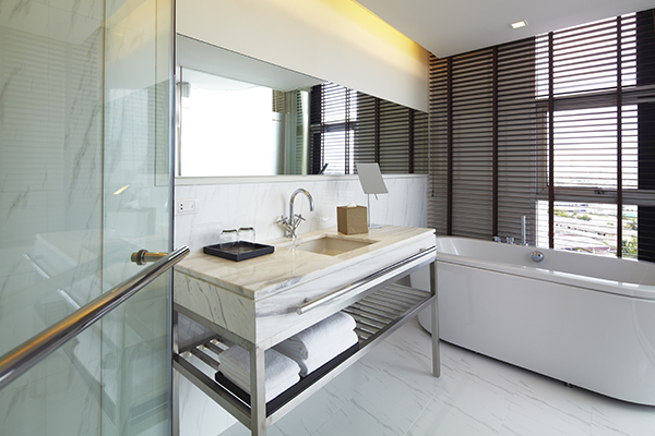 big en suite bathroom with shower, spa bath, toilet and large mirrors in air conditioned 3 Bedroom Apartment suite at Oaks Bangkok Sathorn hotel in Thailand