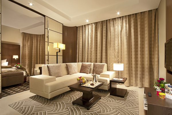 big living room with free Wi-Fi access, air con and satellite TV in Deluxe Suite holiday apartment at Oaks Liwa Executive Suites hotel in Abu Dhabi, United Arab Emirates